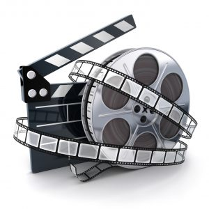 Movie Clapboard And A Reel.