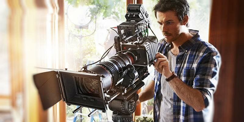 A Camera Man Working With A Professional Film Camera For A Commercial Film.