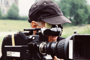A Movie Camera Man With A Video Camera.