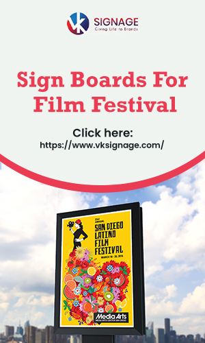 A Bright Colored Vertical Sign Board Advertisement About The Film Festival On The City Street In The Sky Background.